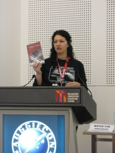 kirstyn reading from Scenes from the Second Storey at Aussiecon 4